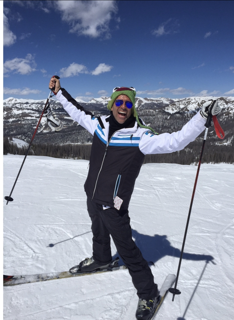 Jeremy James with kermit hat on skiing